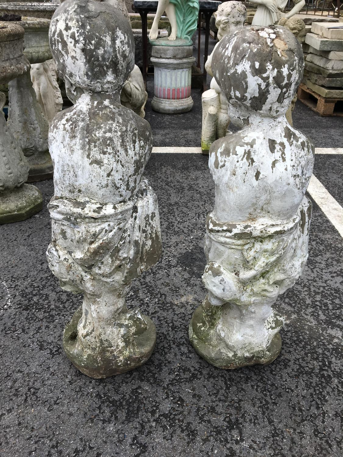 PAIR OF STONE STAUTES OF LITTLE BOYS