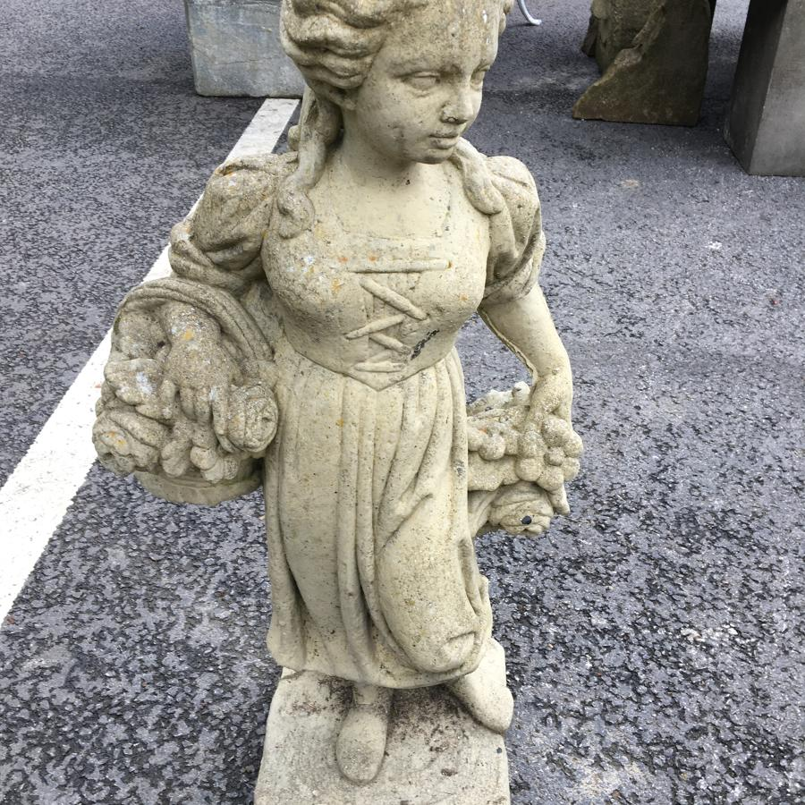 STONE STATUE OF A GIRL