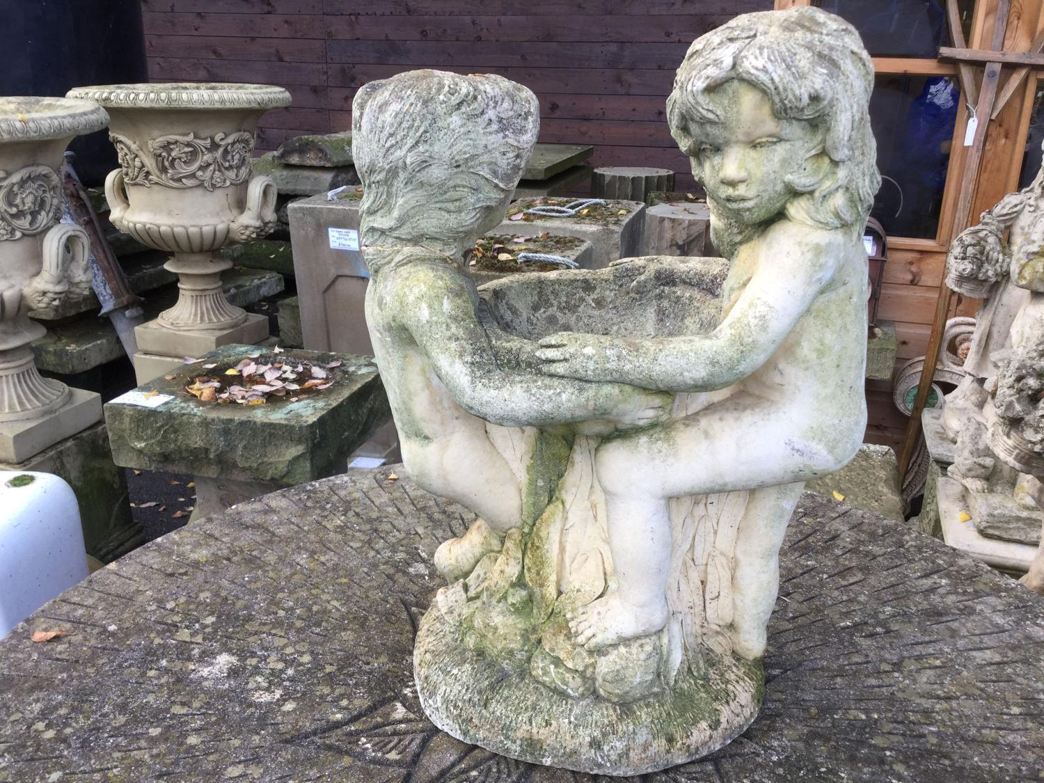 CAST STONE BOY AND GIRL