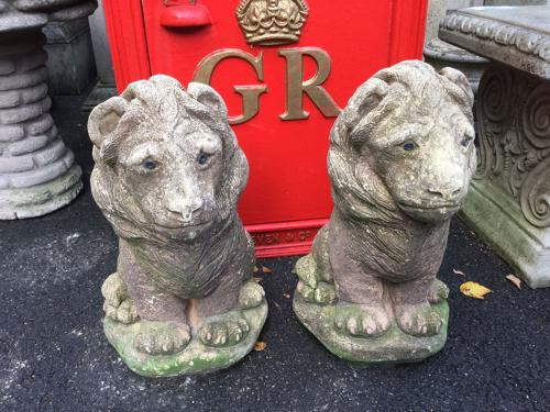 PAIR OF STONE CAST LION