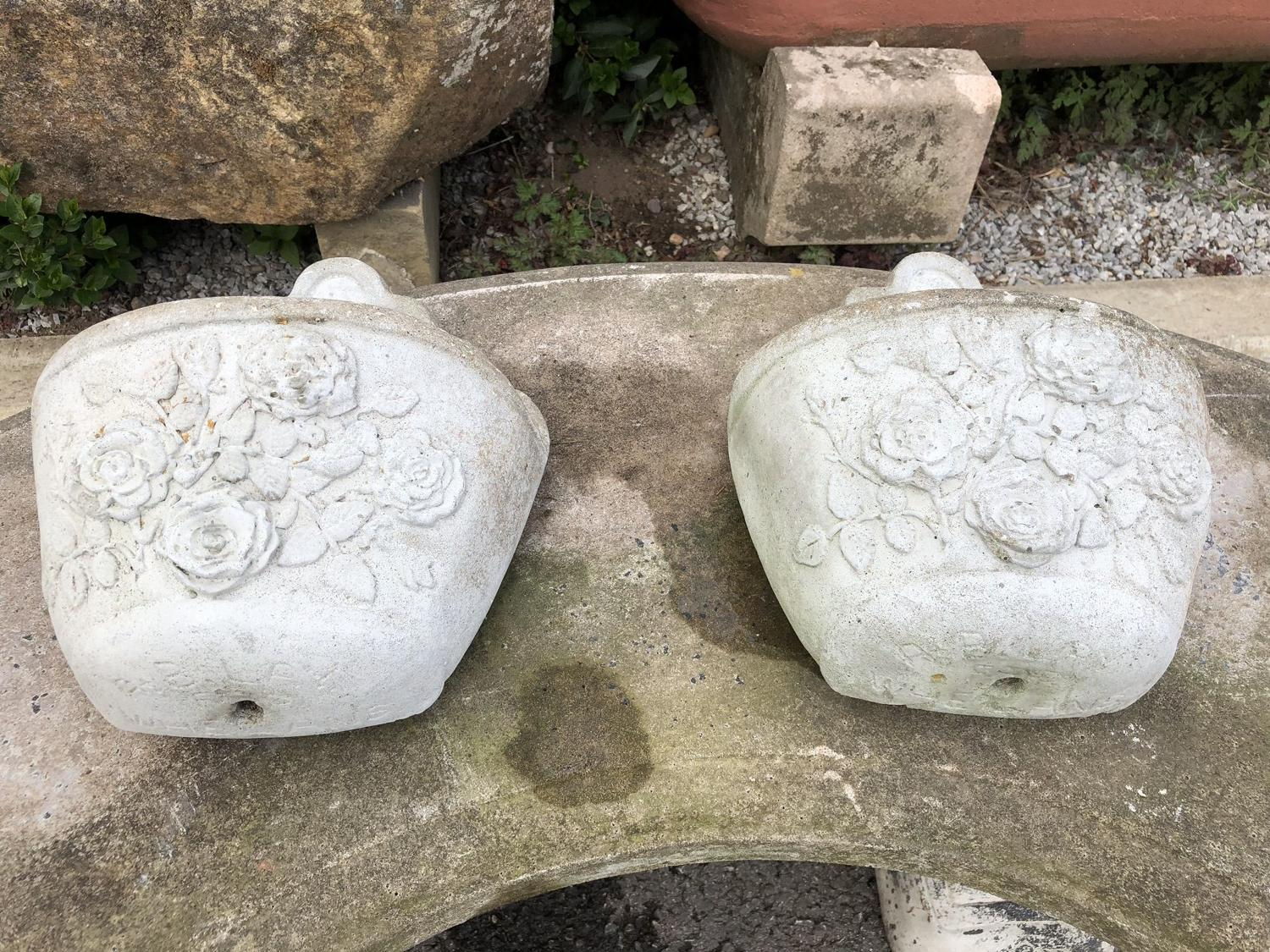 PAIR OF CAST STONE WALL PLANTERS
