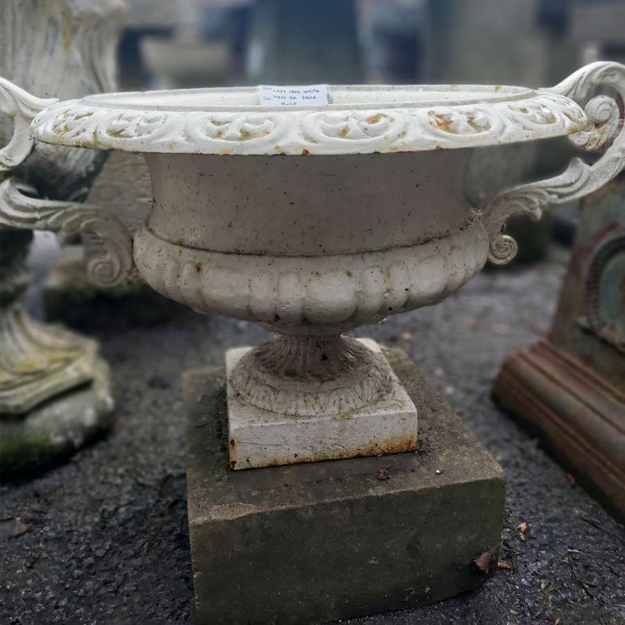 CAST IRON URN ON STONE BASE