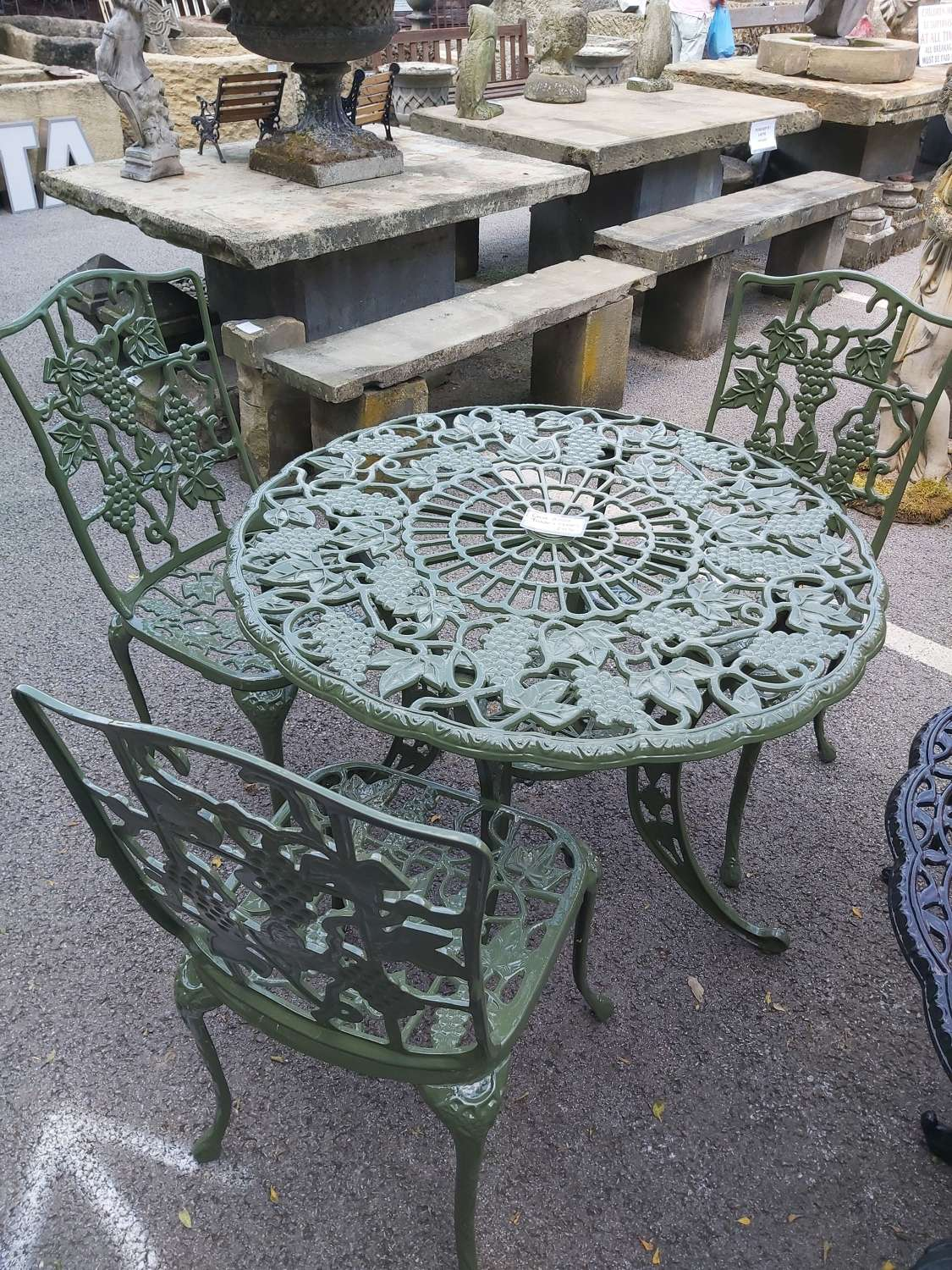 REFURBISHED CAST ALLOY TABLE AND CHAIRS